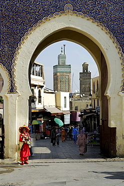 Water vendor standing in front of the Bab Boujeloud city gate, Fes, Morocco, North Africa