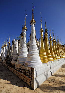 Stupas in front of a blue sky, Inle Lake, Myanmar, Burma, South East Asia