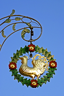 Sign with a golden cock in Beilngries Bavaria Germany.