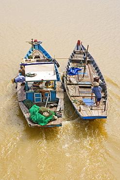 Fishermen on the red river, Da Nang, Vietnam, Asia