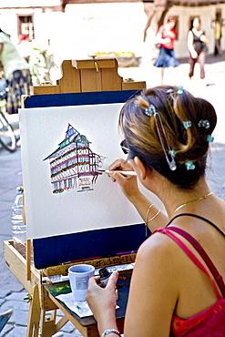 Painter in Petite France, Strasbourg, Alsace, France, Europe