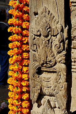Carved wooden coloumn with flower decoration, Patan, Kathmandu, Nepal