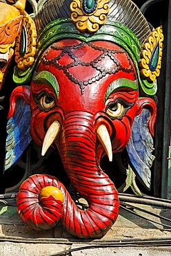 Hinduistic Ganesha, Ganapati, mask, tourist market at Bodhnath, Boudha, Kathmandu, Nepal