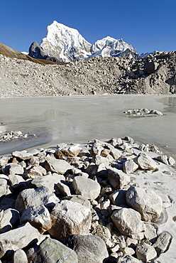 Glacier lake on Ngozumpa glacier with Arakamtse (6423) and Cholatse (6335), Khumbu Himal, Sagarmatha National Park, Nepal
