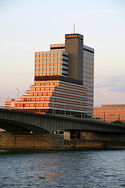 Lufthansa high-rise building and Deutzer Bruecke, Deutzer Bridge illuminated by the sunset at the Rhine River, Cologne, North Rhine-Westphalia, Germany, Europe