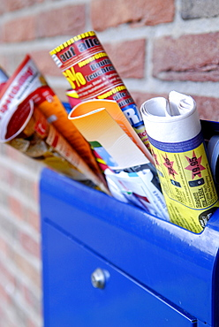 Advertising brochures in a mailbox