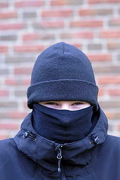 Young man in disguise, face covered