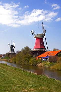 Twin mills in Greetsiel, windmill, built in the style of a two-storey Dutch gallery windmill with a wind rose, Krummhoern Greetsiel, Eastern Frisia, Lower Saxony, Germany, Europe