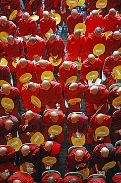 Monk gathering at the induction of a department store, Yangon, Burma, Asia