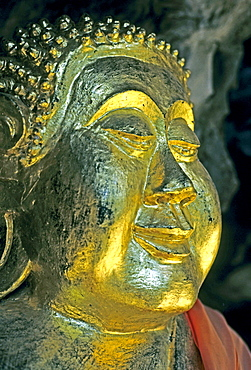 Gilded buddha head, curls ritually twisted from left to right, Luang Prabang, Laos, Asia