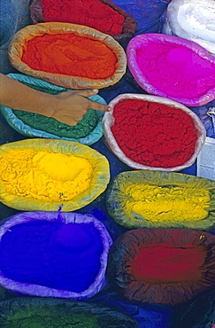 Brightly-coloured sacs of powder at a market, Tihar Festival, five-day festival of light and colour, celebrated annually in October to honour animals, Kathmandu, Nepal, Asia