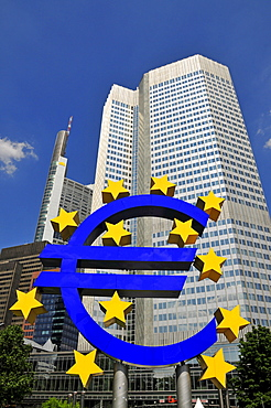 Euro symbol surrounded by stars, in front of multistory buildings, Eurotower of the European Central Bank, Frankfurt, Hesse, Germany