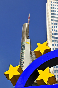 Euro symbol surrounded by stars, in front of multistory buildings, Eurotower of the European Central Bank, left of it headquarters of the Commerzbank, Frankfurt, Hesse, Germany