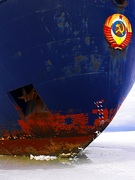 The bow of the Captain Khlebnikov icebreaker in ocean ice in McMurdo Sound, Antarctica