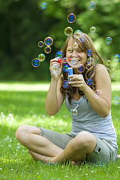 A woman with soap bubbles