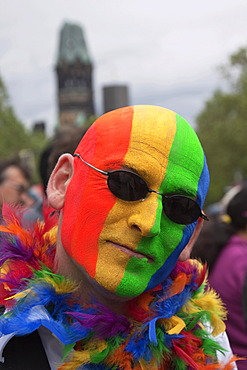 Man's face painted in rainbow colours, on the CSD Christopher Street Day in Berlin on 19 June 2010, Germany, Europe