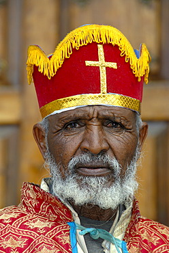 Ethiopian Orthodox Christianity portrait bishop with colourful crown in front of the New Cathedral Axum Ethiopia