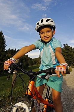 Girl, 7, riding a mountain bike