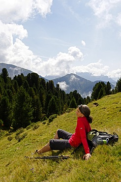 Hiker at the Raschötz or Rasciesa mountain pasture, near St. Ulrich, Val Gardena valley, Southern Tyrol, Alto Adige, Italy, Europe