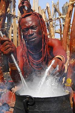 Cooking Himba women, Purros, Kaokoveld, Namibia