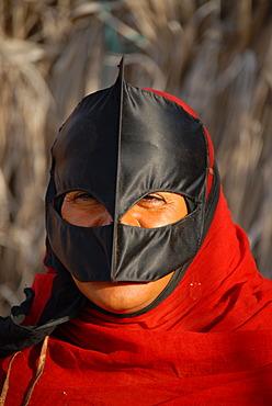 Beduin woman with traditional mask, Wahiba Sands (Wahiba desert), Oman