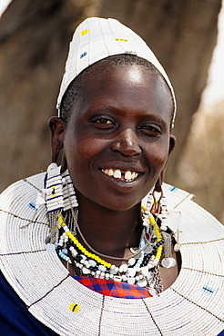 Young Massai woman with typical headdress in Kiloki village, Serengeti, Tanzania, Africa