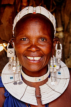 Massai woman with traditional headdress in Kiloki village, Serengeti, Tanzania, Africa