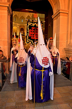 Penitents, Nazarenos, in their typical hooded robes during the festivities of Semana Santa, Holy Week, procession, Good Friday, Alicante, Costa Blanca, Spain, Europe
