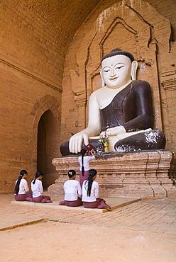 Burmese women praying to Buddha, Bagan, Myanmar