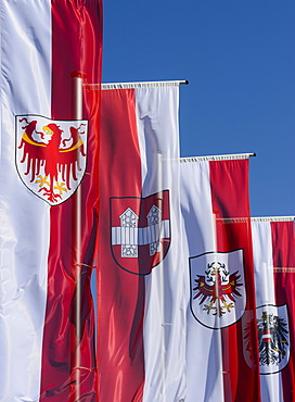 "Flags for the Autonomous Province of South Tyrol, the town of Innsbruck, Tyrol and the Republic of Austria, forecourt of the ""Tirol Panorama"" Museum, at Bergisel, Innsbruck, Tyrol, Austria, Europe, PublicGround"