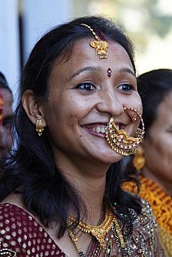 Female wedding guest wearing jewelry, Golu Devta Temple or Golu Devata Temple, Temple of the Bells, a temple for the God Golu, Ghorakhal, Uttarakhand, North India, India, Asia