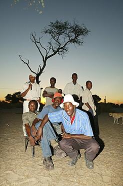 Group of community men gathering under the village tree, Sehitwa, Botswana, Africa