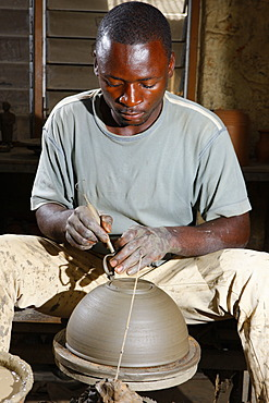Man working at a potter's wheel producing pottery, Bamessing, Cameroon, Africa