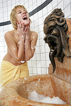 AUT, Austria, Neustift-Milders, Stubai Valley: Wellness. young woman in a spa. Cooling after a sauna bath. Wellness-Spa Hotel Milderer Hof. |