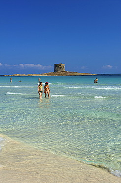 Beach with the Torre della Pelosa tower at back, Sardinia, Italy, Europe