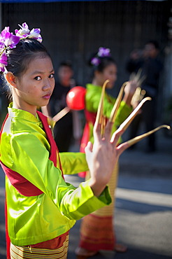 Young female dancer at a street parade in Chiang Mai, Thailand, Asia