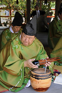 Musicians at the Aoi Festival holding a Sho wooden mouth organ in the Kamigamo Shrine in Kyoto, Japan, Asia