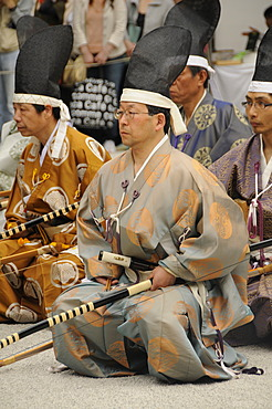 Archers kneeling in the Shrine courtyard after devotion at the archery ceremonial in Shimogamo Shrine, Kyoto, Japan, Asia