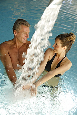 Woman and man in a pool, spa