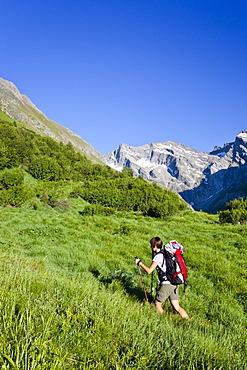 Mountain climber passing through Pfitschertal Valley while ascending Hochfeiler Mountain, Alto Adige, Italy, Europe