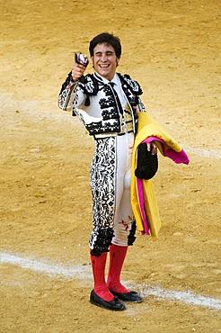 Torero presenting cut off ears of conquered bull, Benidorm, Spain, Europe