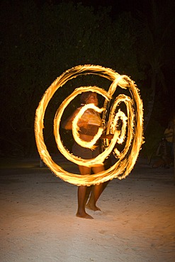 Fire artist performing at an evening event held for tourists in Honduras, Central America