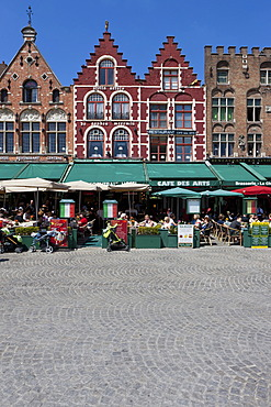 Guild houses and outdoor restaurants in Grote Markt square, historic centre of Bruges, UNESCO World Heritage Site, West Flanders, Flemish Region, Belgium, Europe
