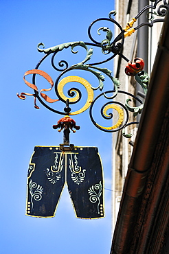 Hanging sign of a traditional costume shop, Residenzplatz square, Salzburg, Austria, Europe