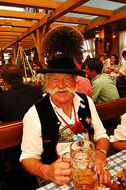Bavarian man in tradtional costume, Wies\'n, October fest, Munich, Bavaria, Germany, Europe