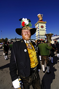 Man wearing a traditional costume in a procession, Wies\'n, Oktoberfest, Munich, Bavaria, Germany, Europe