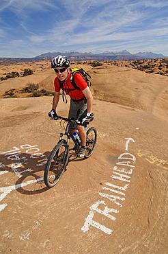 Mountain biker on Slickrock Trail, Moab, Utah, USA