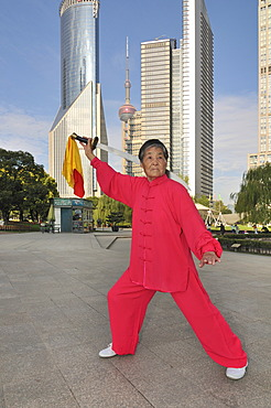 Old woman exercising, swordplay, Lujiazui Park, Oriental Pearl Tower, Pudong, Shanghai, China, Asia