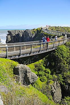 Tourists visiting the Pancake Rocks rock formations, Punakaiki, Paparoa National Park, South Island, New Zealand