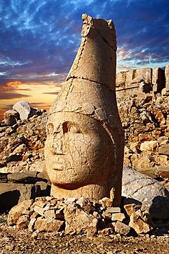 Broken statues around the tomb of Commagene King Antochius I on top of Mount Nemrut, Turkey